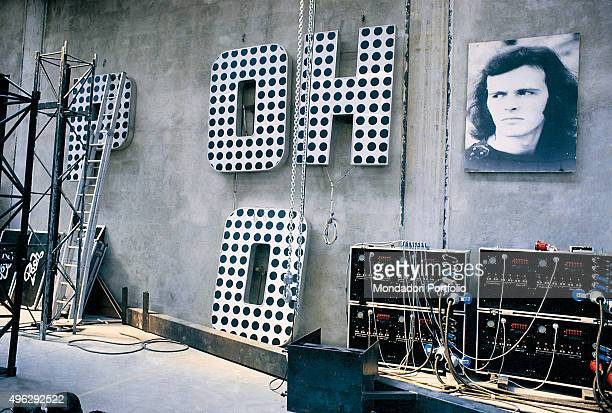 Interior view of the hangar with the equipments and the service for the summer tour of Italian band Pooh. On the wall, the letters of the band name...
