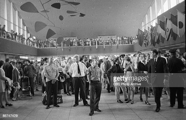 Interior view of the International Arrival Building at John F Kennedy International Airport shows a crowd of passengers as they stand under a massive...
