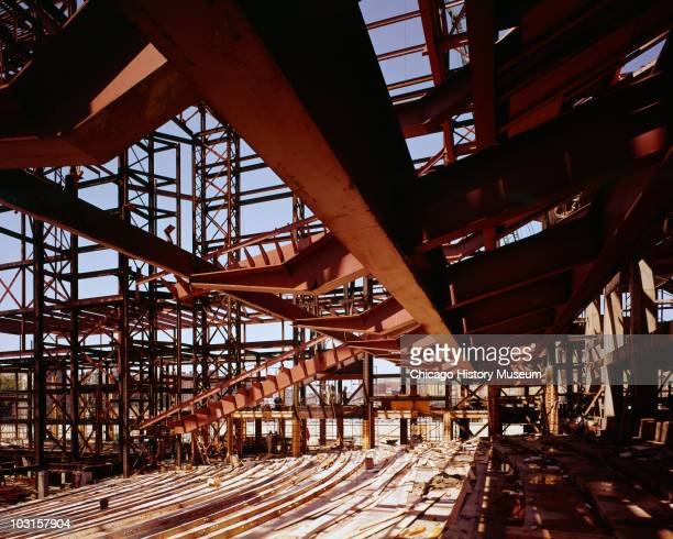 Interior view of the steel framework with an Ibeam cutting through the image for the Performing Arts Center later known as the Marcus Center for the...