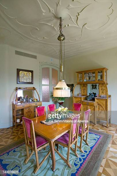 Interior view of vintage dining room table of Casa Mila or La Pedrera by Antoni Gaudi built between 19051911 Barcelona Spain