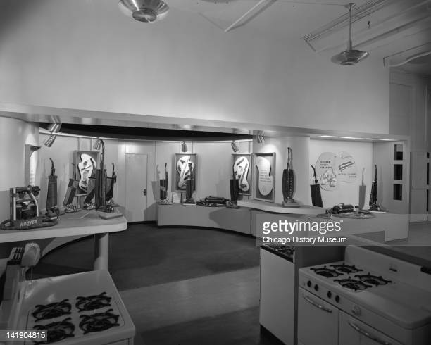 Interior views of appliance department at Marshall Field Store Refrigerators stoves and vacuum cleaners are displayed Also shown is area with seating...