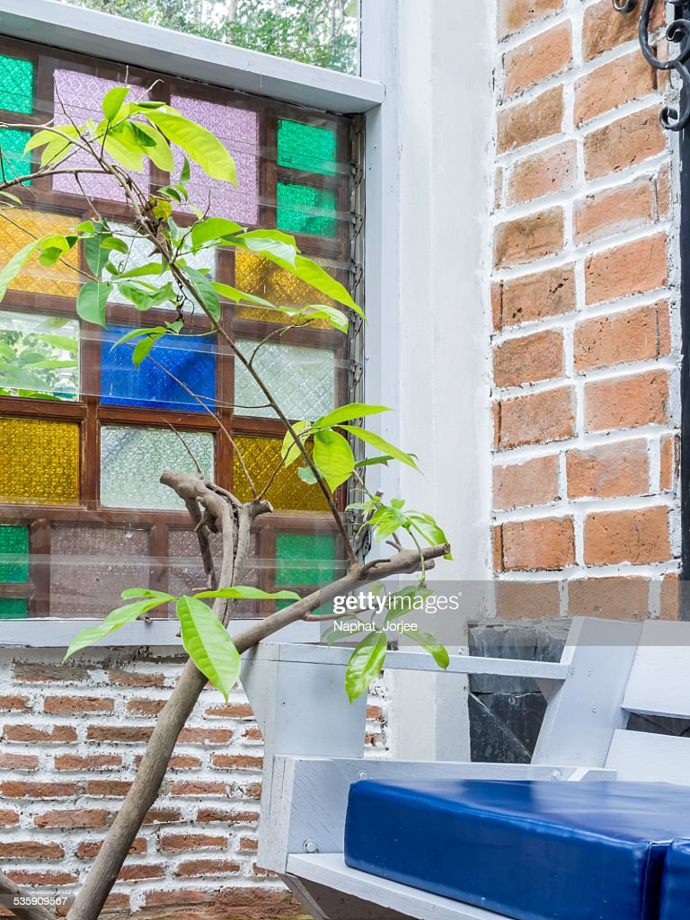 Interior vintage brick  wall with wooden armchair : Stock Photo
