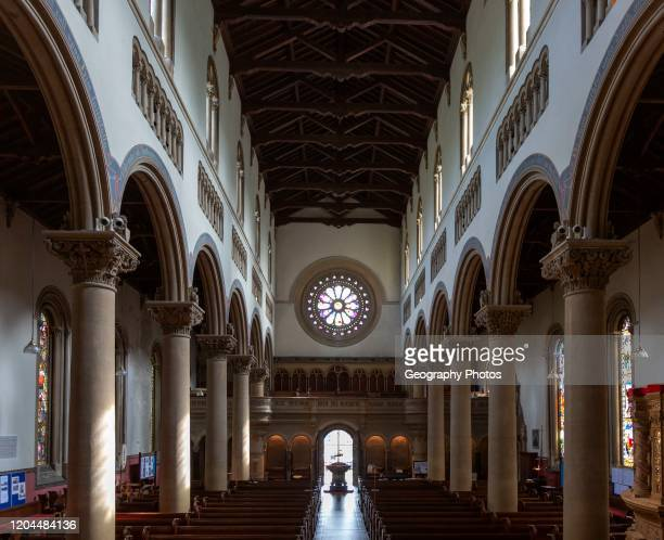 Interior Wilton Italianate church, Wiltshire, England, UK nave and round window above entrance built 1844.