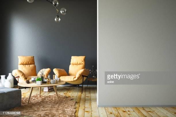interieur mit sessel und leere wand - innenaufnahme stock-fotos und bilder
