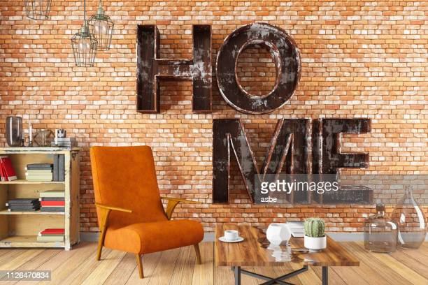 interior with armchair and home shelf - home sweet home stock pictures, royalty-free photos & images