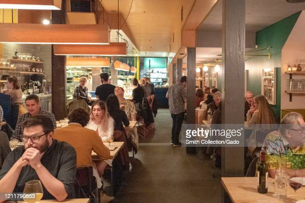 Interior with diners visible at State Bird Provisions a Michelin starred restaurant widely considered to be among the top restaurants in San...