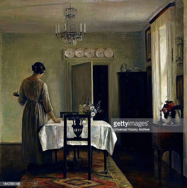 Interior with woman by Carl Wilhelm Holsoe a highly respected artist of the Danish school He painted quite a few in this series of a woman alone in...