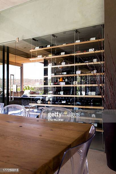 Interiors of a room with wine rack in the background
