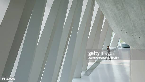 interiors of corridor of modern building - architectural column stock pictures, royalty-free photos & images
