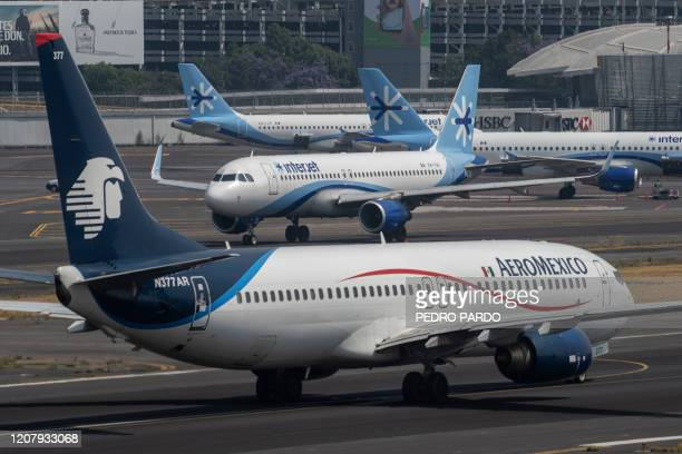 Interjet and Aeromexico planes prepare to take off at the Benito Juarez International airport in Mexico City on March 20 2020 International flights...
