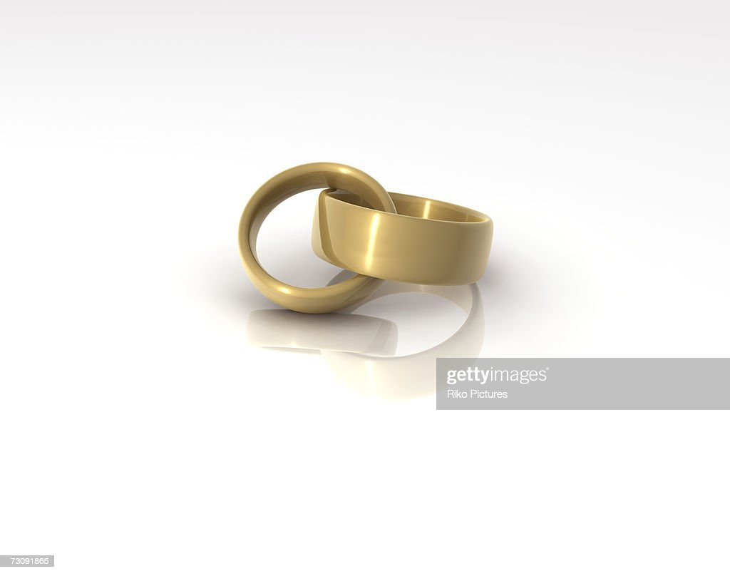 Interlinked Wedding Rings Closeup Stock Photo Getty Images