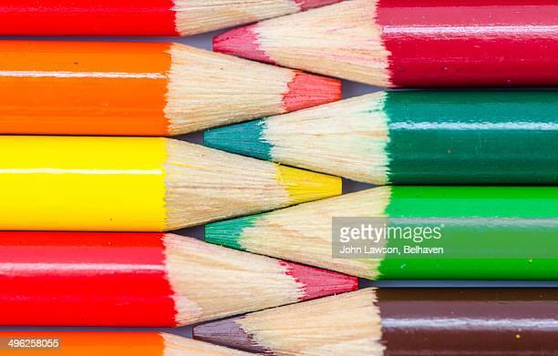 Interlocking summer and autumn coloured pencils
