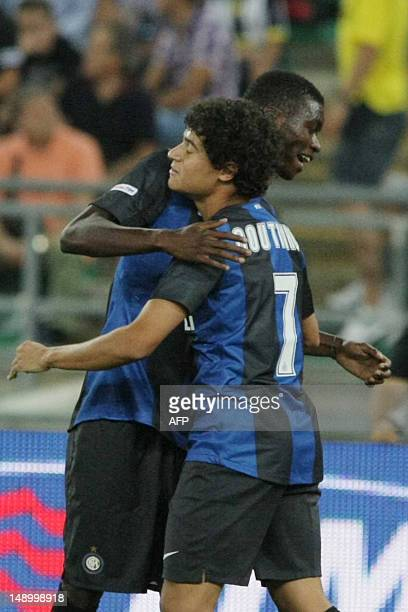 Intermilan player Philippe Couthino celebrates with his teammate after scoring a goal against FC Juventus during triangle football match TIM Trophy...