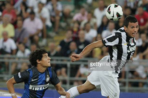 Intermilan player Philippe Couthino look Lucio FC Juventus jump for the ball during triangle football match TIM Trophy at San Nicola Stadium in Bari...