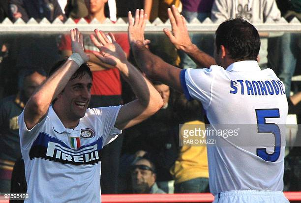 Intermilan's Diego Milito of Argentina celebrates with team player Dejan Stankovic of Serbia after scoring a goal against Livorno during their serie...
