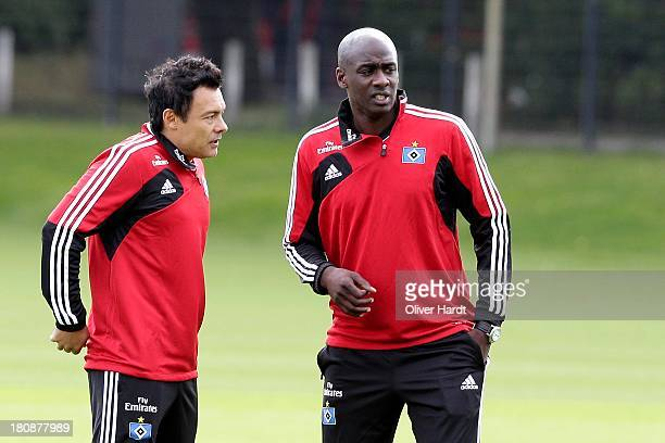 Intern coach Rodolfo Cardoso and Otto Addo of Hamburg is seen during a Hamburger SV training session at Imtech Arena on September 17 2013 in Hamburg...
