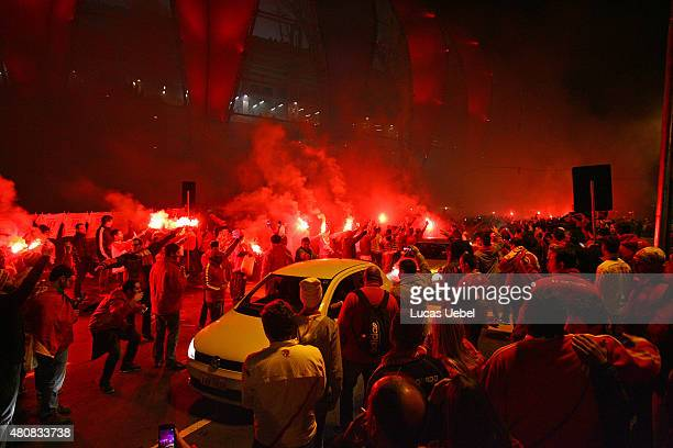 Internacional fans waiting for their team with fire signaling in a event called Streets of Fire before the match between Internacional v Tigres as...