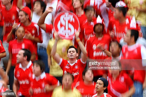 Internacional supporters cheer their team before the start of the Brazilian Championship final date match against Santo Andre at Beira Rio Stadium on...