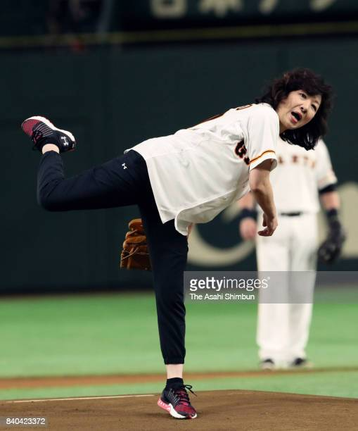Internal Affairs and Communications Minister Seiko Noda throws the memorial first pitch prior to the game between Yomiuri Giants and Hanshin Tigers...