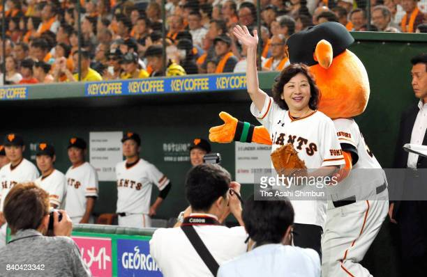 Internal Affairs and Communications Minister Seiko Noda waves to crowd before throwing the memorial first pitch prior to the game between Yomiuri...