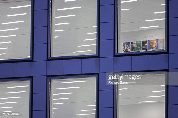 Internal lighting seen in a still vacant office space in the City of London UK Artwork has been placed on one rear wall to show local views of the...