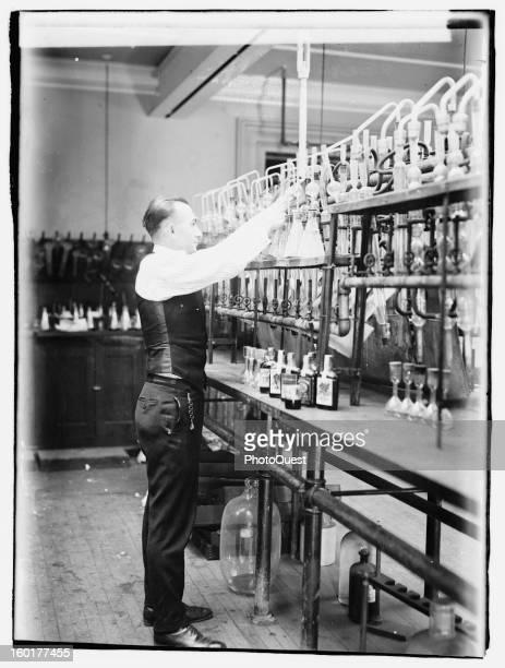 Internal Revenue Bureau chemist George F. Beyer tests bootleggers' booze in his laboratory, 1920.