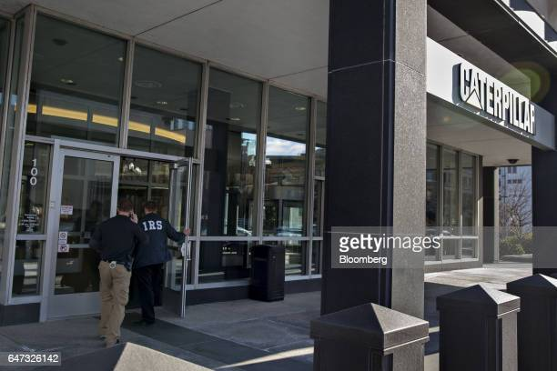 US Internal Revenue Service special agents enter the Caterpillar Inc headquarters in Peoria Illinois US on Thursday March 2 2017 Caterpillar shares...