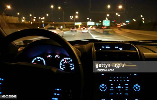 Internal view of a moving car on a dark highway