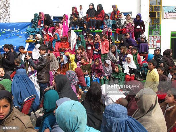 Internally displaced Afghan children attend a graduation ceremony organized by the Mobile Mini Circus for Children in Kabul, Afghanistan March 11,...
