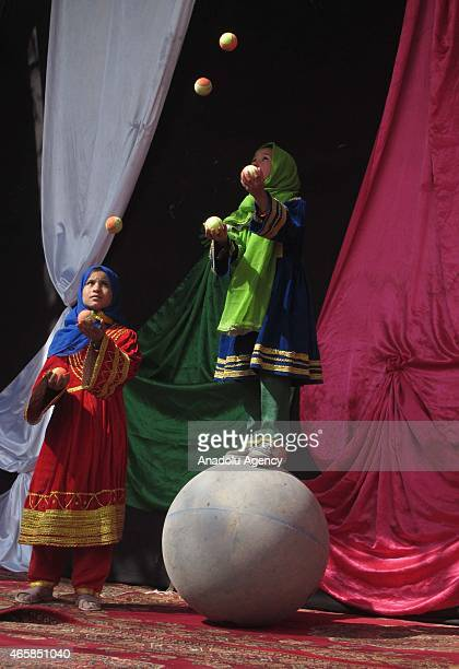 Internally displaced Afghan children perform during a graduation ceremony organized by the Mobile Mini Circus for Children in Kabul, Afghanistan...
