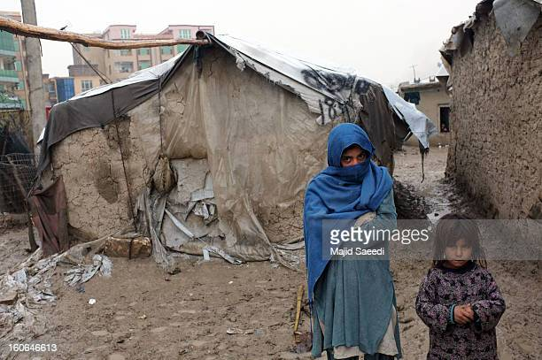 Internally displaced Afghan children wait for aid from the Danish Refugee Council at Chamand babrak Camp, on February 3, 2013 in Kabul, Afghanistan....