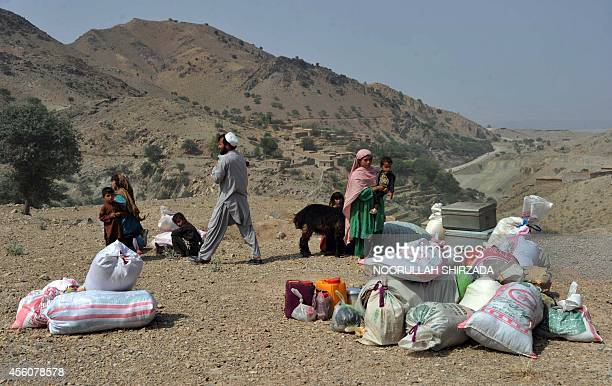 Internally displaced Afghan civilians flee an Afghan military operation against Taliban insurgents in Dur Baba district near the PakistanAfghanistan...