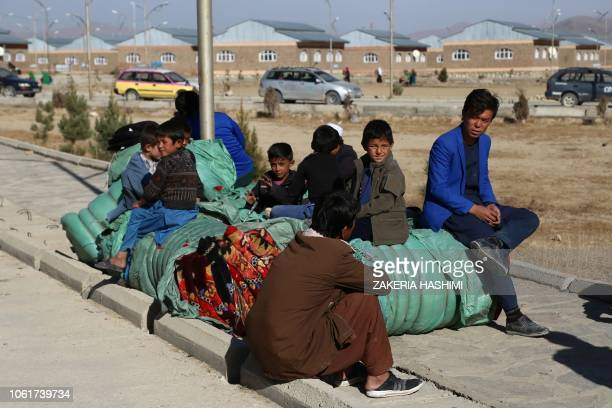 Internally displaced Afghan civilians rest after fleeing from Jaghori district to escape ongoing battles between Taliban and Afghan security forces...
