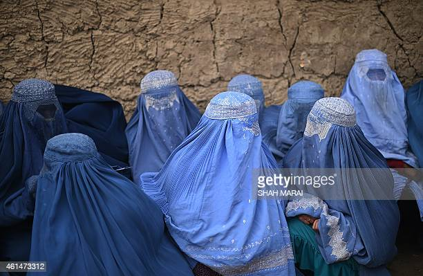 Internally displaced Afghan women wait for food relief aid from the World Food Programme in Kabul on January 13 2015 The UN says about 782000 people...