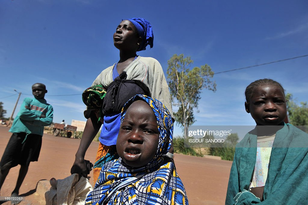 Internally displaced Aminata Foumba arrives near the city of Niono from Diabaly after a six day walk with her children, on January 19, 2013, in city of Niono. Ivorian President Alassane Ouattara on January 19 called for a broader international commitment to the military operations in Mali, where Malian and French forces are battling Islamist militant groups that control the country's vast arid north. Some 2,000 members of MISMA (the International Mission for Mali Assistance), the African intervention force, are expected to be deployed by January 26. About 100 soldiers from Togo and Nigeria have already arrived in Bamako, and another 30 or so from Benin are en route to join them.
