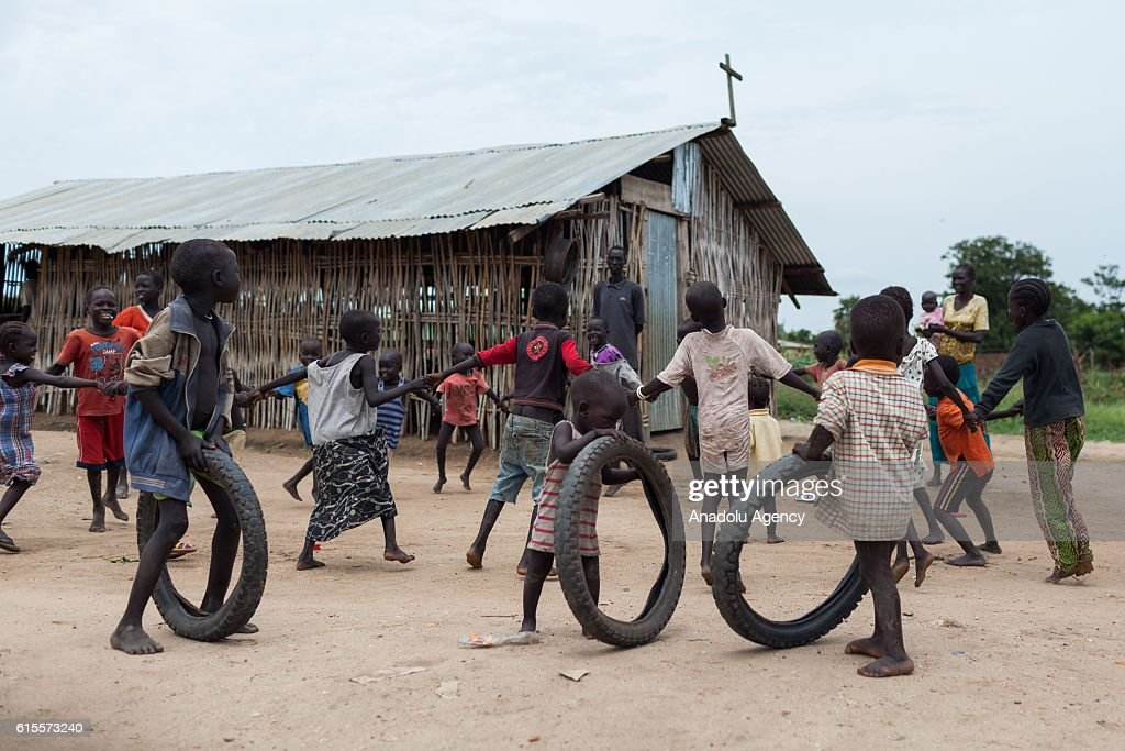 Internally displaced children play at Saint Mary camp, which has been set up near a cemetery in Juba, South Sudan on October 18, 2016.