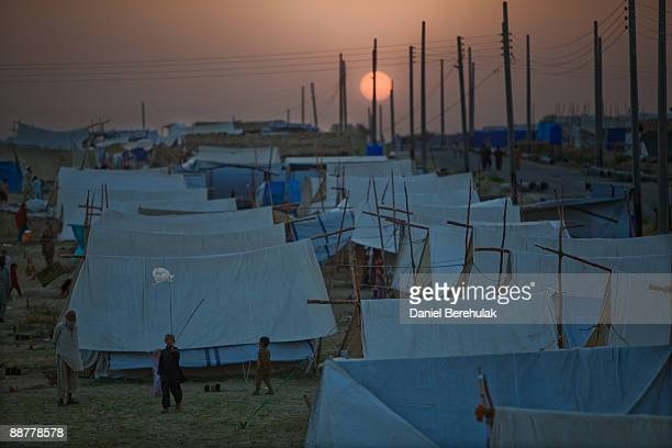 Internally displaced children play in front of their tents at a the Shah Mansoor IDP camp on July 1 2009 in Swabi District Pakistan Approximately 3...
