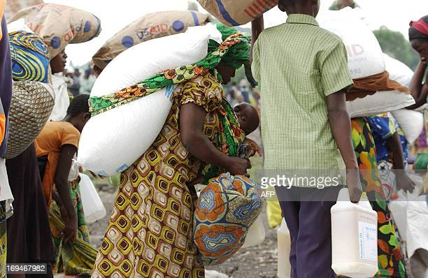 Internally Displaced People collect goods during a food distribution program at an IDP camp in Mugunga 15km outside of Goma on May 25 2013 The camp...