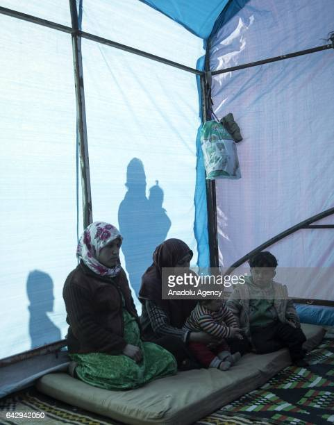 Internally displaced people fled from al Bab district of Aleppo due to Daesh are seen in a tent as they take shelter in the opposition controlled...