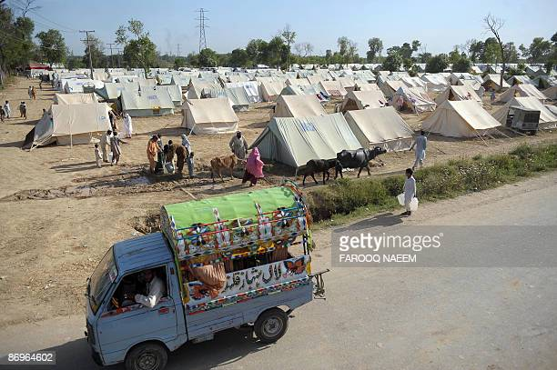 Internally displaced people fleeing from military operations against Taliban militants in troubled Swat valley and Buner arrive at Jalala makeshift...
