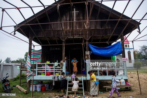 Internally displaced people, fleeing renewed fighting between Myanmar's army and ethnic insurgents in the country's remote north, take shelter at a...