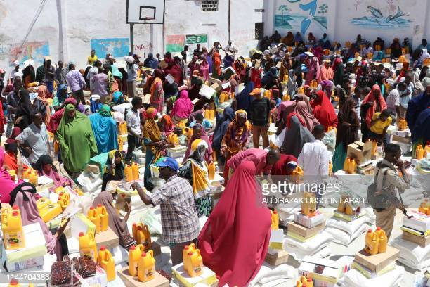 Internally displaced people gather in the Shingani District of the Somali capital Mogadidshu to collect food rations being distributed to the...
