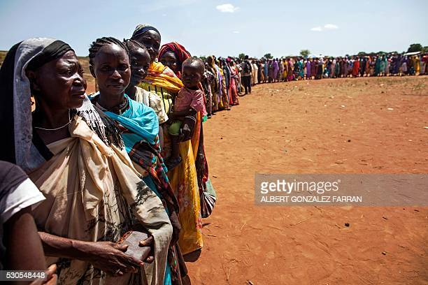 TOPSHOT Internally displaced people recently arrived to Wau South Sudan due to armed clashes in surrounding villages wait to be registered by the...