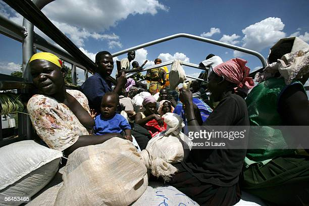 Internally Displaced people travel on a truck from the Pabo refugee Camp on December 10 2005 in the outskirt of Gulu Uganda Up to 22000 displaced...