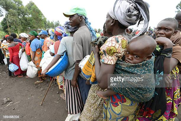 Internally Displaced People wait in line during a food distribution program at an IDP camp in Mugunga 15km outside of Goma on May 25 2013 The camp is...