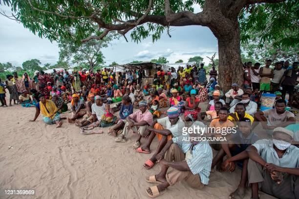 Internally displaced persons gather for a community meeting in the Tara Tara district of Matuge, northern Mozambique, February 24, 2021. - The place...