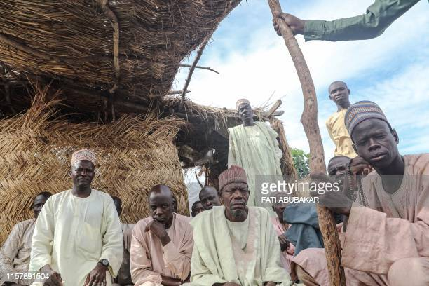Internally displaced persons gather on July 21, 2019 at the Muna camp in Maiduguri. - Boko Haram's decade-long conflict has killed 27,000 people and...