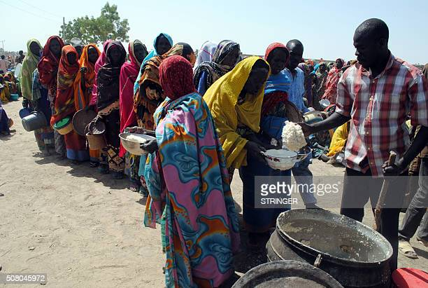 Internally Displaced Persons mostly women and children sit waiting to be served with food at Dikwa Camp in Borno State in northeastern Nigeria on...