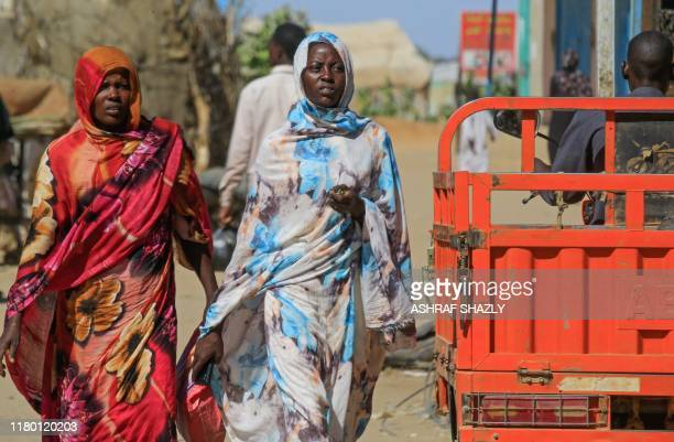 Internally displaced Sudanese women walk to a market in Abu Shouk camp nearly 20 kms north of ElFasher the capital of the North Darfur state on...