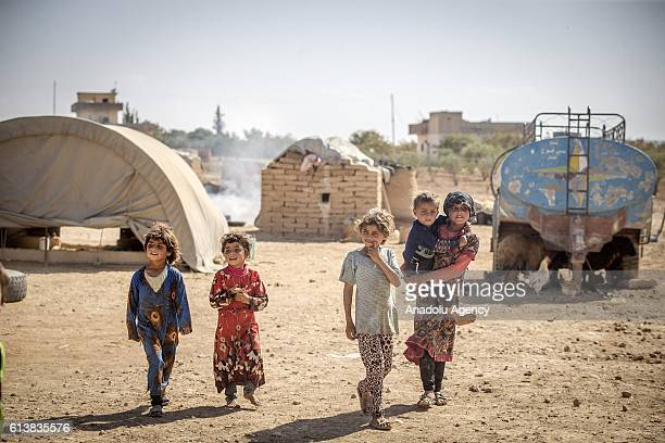 Internally displaced Syrians fled from clashes as well as Daesh terrorists' and Assad Regime's attacks stay at the makeshift camps near the border of...